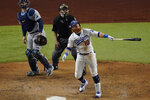 Los Angeles Dodgers' Justin Turner flies out against the Tampa Bay Rays during the sixth inning against the Tampa Bay Rays a baseball World Series Game 6 Tuesday, Oct. 27, 2020, in Arlington, Texas. (AP Photo/Sue Ogrocki)