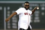 Former Boston Red Sox's David Ortiz throws out a ceremonial first pitch before a baseball game against the New York Yankees in Boston, Monday, Sept. 9, 2019. (AP Photo/Michael Dwyer)