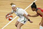 Minnesota Lynx guard Rachel Banham (15) dribbles in the second half of a WNBA basketball game against the Washington Mystics in Minneapolis, Saturday, May 8, 2021. (Renee Jones Schneider/Star Tribune via AP)
