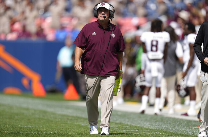 Texas A&M head coach Jimbo Fisher walks the sideline in the first half of an NCAA college football game against Colorado, Saturday, Sept. 11, 2021, in Denver. (AP Photo/David Zalubowski)