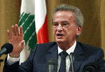 Riad Salameh the governor of Lebanon's Central Bank, speaks during a press conference, in Beirut, Lebanon, Monday, Nov. 11, 2019. Salameh pledged to safeguard the stability of the Lebanese currency and said the bank has taken measures to protect deposits. Salameh said at the press conference that the central bank will keep defending the currency peg, which has been stable since 1997. (AP Photo/Hussein Malla)