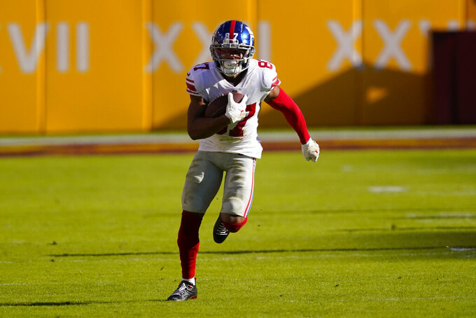 New York Giants wide receiver Sterling Shepard (87) runs with the ball in the first half of an NFL football game against the Washington Football Team, Sunday, Nov. 8, 2020, in Landover, Md. (AP Photo/Al Drago)