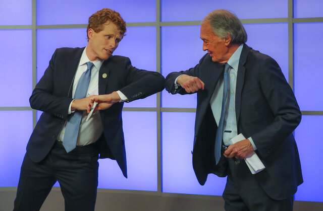 Rep. Joe Kennedy III, left, elbow-bumps Sen. Edward Markey after their debate for the Democratic primary for senator from Massachusetts, Monday, June 1, 2020, in Springfield, Mass. (Matthew J. Lee/The Boston Globe via AP, Pool)