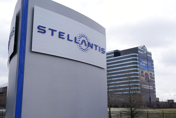 FILE - This Jan. 19, 2021 file photo shows the Stellantis sign outside the Chrysler Technology Center in Auburn Hills, Mich. Luxury automaker Mercedes-Benz is teaming up with Stellantis and TotalEnergies in a European electric vehicle battery joint venture, Automotive Cells Co. The partners in Automotive Cells plan to increase the company's industrial capacity to at least 120 gigawatt-hours by 2030. (AP Photo/Carlos Osorio, File)