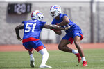 Buffalo Bills defensive lineman Bryan Cox Jr. (51) and defensive lineman Greg Rousseau compete in a drill during NFL football practice Tuesday, May 25, 2021, in Buffalo, N.Y. (AP Photo/Joshua Bessex)