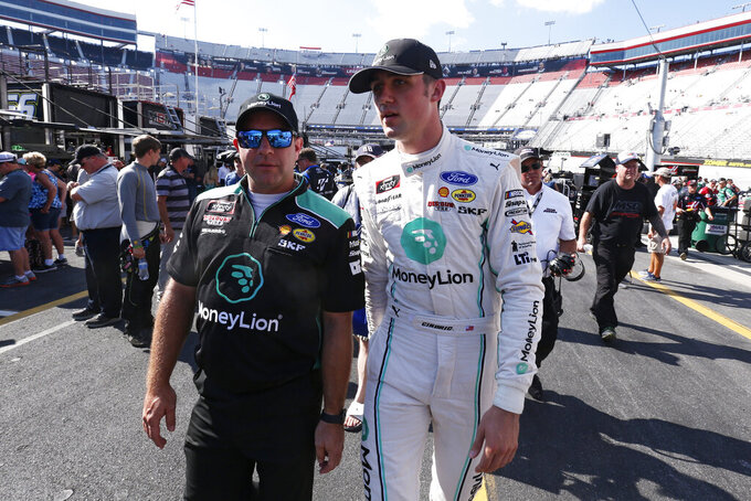 Austin Cindric, front right, walks through the pits after winning the pole for a NASCAR Xfinity Series auto race on Friday, Aug. 16, 2019, in Bristol, Tenn. (AP Photo/Wade Payne)
