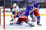 New York Rangers goalie Alexandar Georgiev stops New York Islanders' Brock Nelson (29) during the third period of an NHL hockey game Saturday, Jan. 16, 2021, in New York. (Bruce Bennett/Pool Photo via AP)