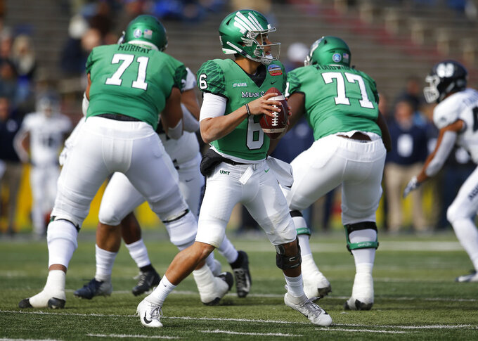 North Texas quarterback Mason Fine (6) searches for a receiver during the first half of the New Mexico Bowl NCAA college football game against Utah State in Albuquerque, N.M., Saturday, Dec. 15, 2018. (AP Photo/Andres Leighton)