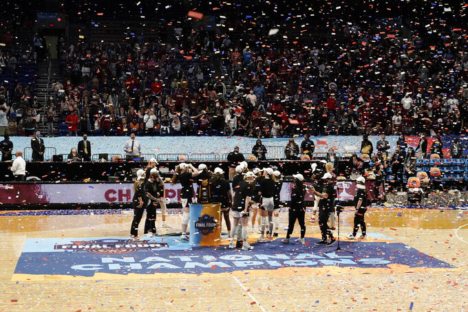 FILE - Stanford players celebrate on the court after the championship game against Arizona in the women's Final Four NCAA college basketball tournament in San Antonio, in this Sunday, April 4, 2021, file photo. A law firm hired to investigate gender equity concerns at NCAA championship events released a blistering report Tuesday, Aug. 3, 2021, that recommended holding the men's and women's Final Fours at the same site and offering financial incentives to schools to improve their women's basketball programs. (AP Photo/Morry Gash, File)