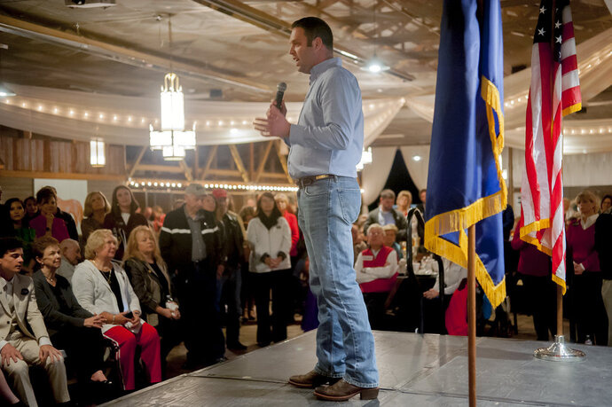 FILE - In this Nov. 5, 2018 file photo, State Rep. Michael Meredith, R-Brownsville, speaks at a Republican Party rally at Highland Stables in Bowling Green, Ky. Republican leaders in Kentucky have restored the lawmaker to his leadership position one year after he signed a secret sexual harassment settlement. Meredith was one of four Republican lawmakers who signed the settlement in 2017 with a woman who once worked for the House GOP Caucus. Meredith was renamed chairman of the House Local Government Committee on Wednesday, Dec. 5, 2018. (Bac Totrong/Daily News via AP, File)