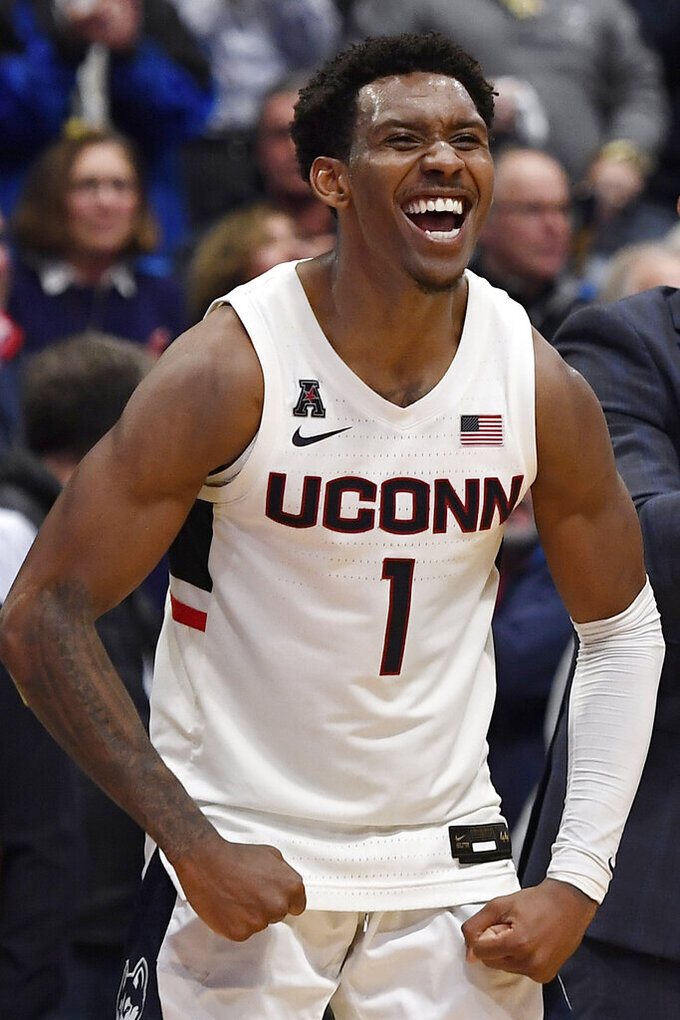 Connecticut's Christian Vital reacts in the second half of an NCAA college basketball game against Central Florida, Wednesday, Feb. 26, 2020, in Hartford, Conn. (AP Photo/Jessica Hill)