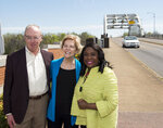 Democratic presidential candidate Sen. Elizabeth Warren, D-Mass., poses with her husband, Bruce Mann, left, and Rep. Terri Sewell, right, in front of the historic Edmund Pettus Bridge in Selma, Ala., on Tuesday, March 19, 2019. (Jake Crandall/The Montgomery Advertiser via AP)