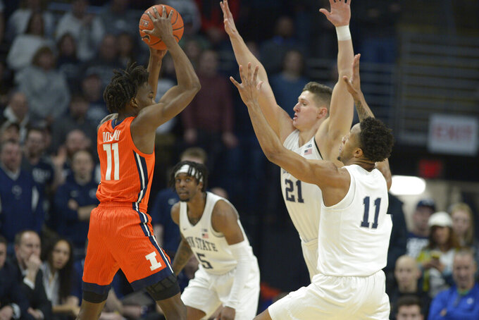 CORRECTS TEAM FROM NORTHWESTERN TO ILLINOIS - Penn State's John Harrar (21) and Lamar Stevens (11) pressure Illinois' Ayo Dosunmu (11) during the first half of an NCAA college basketball game Tuesday, Feb. 18, 2020, in State College, Pa. (AP Photo/Gary M. Baranec)