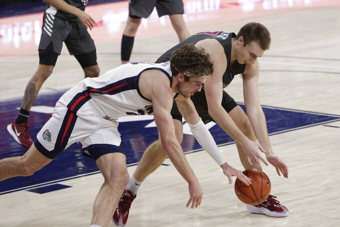 Gonzaga forward Corey Kispert, left, and Santa Clara forward Josip Vrankic chase down the ball during the second half of an NCAA college basketball game in Spokane, Wash., Thursday, Feb. 25, 2021. (AP Photo/Young Kwak)