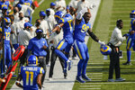 Los Angeles Rams' Robert Woods (17) and Michael Brockers (90) celebrate after Woods scored a touchdown during the second half of an NFL football game against the Buffalo Bills Sunday, Aug. 26, 2018, in Orchard Park, N.Y. (AP Photo/John Munson)