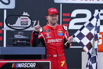 Justin Allgaier (7) poses with his trophy in Victory Lane as he celebrates after winning a NASCAR Xfinity Series auto race Saturday, Sept. 12, 2020, in Richmond, Va. Allgaier swept the two days of racing in the Xfinity Series. (AP Photo/Steve Helber)