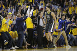 Golden State Warriors guard Klay Thompson (11) celebrates with fans after scoring against the Portland Trail Blazers during the second half of Game 2 of the NBA basketball playoffs Western Conference finals in Oakland, Calif., Thursday, May 16, 2019. (AP Photo/Jeff Chiu)