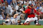 Boston Red Sox's Kevin Plawecki (25) makes the out on New York Yankees' Brett Gardner trying to score on a fielders choice during the sixth inning of a baseball game, Saturday, Sept. 25, 2021, in Boston. (AP Photo/Michael Dwyer)
