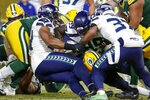 Green Bay Packers' Aaron Jones runs for a touchdown during the first half of an NFL divisional playoff football game against the Seattle Seahawks Sunday, Jan. 12, 2020, in Green Bay, Wis. (AP Photo/Matt Ludtke)