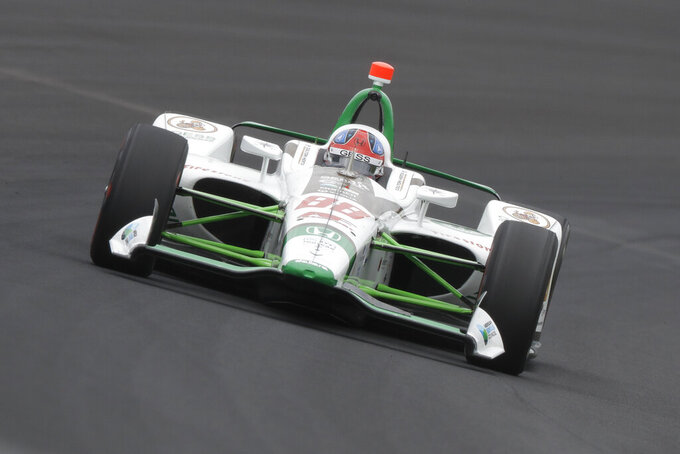 Colton Herta drives through turn one during practice for the Indianapolis 500 IndyCar auto race at Indianapolis Motor Speedway, Friday, May 17, 2019 in Indianapolis. (AP Photo/Darron Cummings)