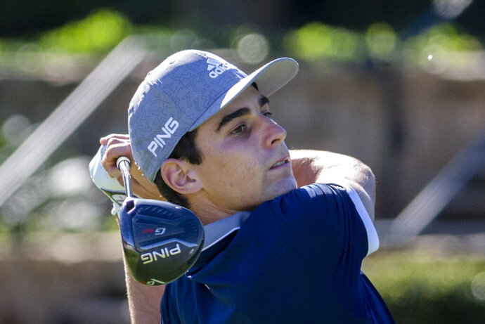 Joaquin Niemann, of Chile, watches his drive down the 10th fairway during third round of the RSM Classic golf tournament, Saturday, Nov. 21, 2020, in St. Simons Island, Ga. (AP Photo/Stephen B. Morton)