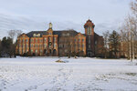In this Dec. 26, 2019, photo, the campus of Saint Anselm College is shown in Manchester, N.H. Monks at a Catholic college in New Hampshire have gone to court in a dispute with the school's board of trustees over an effort to limit their power. The two sides were in Hillsborough Superior Court on Monday, Jan. 6, 2020,  over the lawsuit filed against the Saint Anselm College board last year. The unusual clash was set in motion when the board moved to take away the monks' ability to amend the school's bylaws.(AP Photo/Michael Casey)