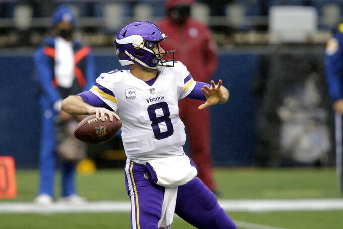 Minnesota Vikings quarterback Kirk Cousins drops back to pass against the Seattle Seahawks during the first half of an NFL football game, Sunday, Oct. 11, 2020, in Seattle. (AP Photo/John Froschauer)