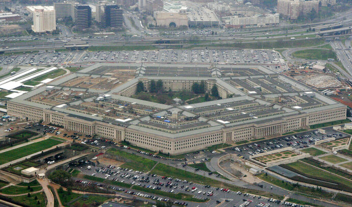 FILE - This March 27, 2008, aerial file photo, shows the Pentagon in Washington. The Pentagon on Friday, Sept. 4, 2020, reaffirmed Microsoft as winner of a cloud computing contract potentially worth $10 billion, although the start of work is delayed by a legal battle over rival Amazon's claim that the bidding process was flawed. (AP Photo/Charles Dharapak, File)