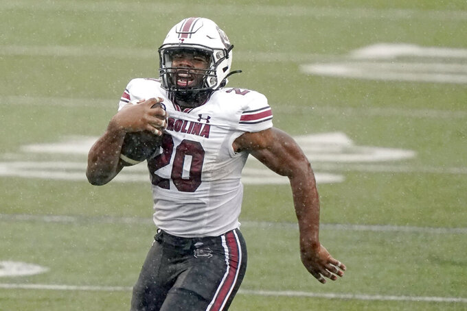 South Carolina running back Kevin Harris runs 88 yards for a touchdown against Vanderbilt in the second half of an NCAA college football game Saturday, Oct. 10, 2020, in Nashville, Tenn. South Carolina won 41-7. (AP Photo/Mark Humphrey)