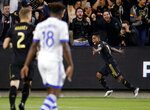 Los Angeles FC forward Latif Blessing (7) celebrates his goal against the Montreal Impact during the first half of an MLS soccer match in Los Angeles, Friday, May 24, 2019. (AP Photo/Ringo H.W. Chiu)