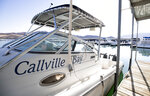 A view of the Callville Bay Marina in the Lake Mead National Recreation Area Tuesday, Sept. 14, 2021 in Las Vegas.  Some businesses that depend on the Colorado River caught a wave of customers after coronavirus pandemic closures closed schools and offices. But boat rental and recreation company chief Chad Taylor says that receding water levels at Lake Mead, the river's drought-stricken reservoir, have him constantly moving docks farther into Callville Bay.  (Steve Marcus /Las Vegas Sun via AP)