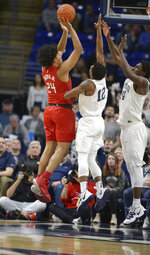 Rutgers Ron Harper Jr. (24) shoots over Penn State's Izaiah Brockington (12) and Mike Watkins (24) during the first half of an NCAA college basketball game, Wednesday, Feb. 26, 2020, in State College, Pa. (AP Photo/Gary M. Baranec)