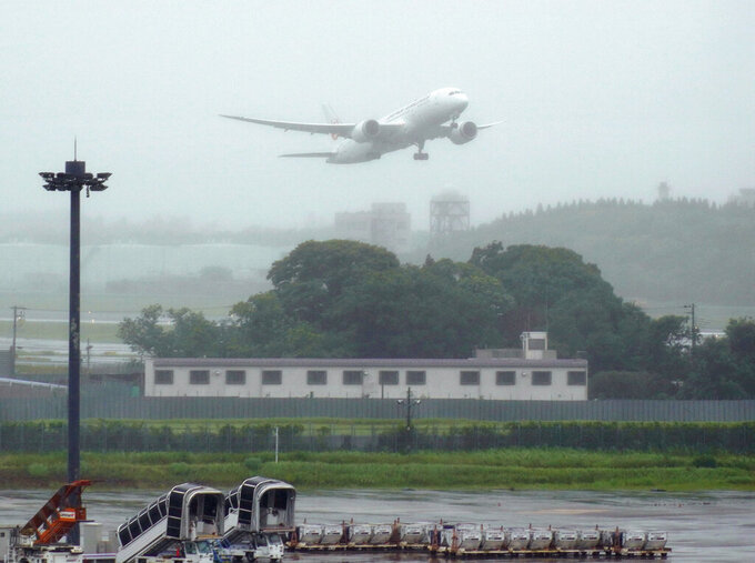 A plane carrying the vaccine cargo donated by Japanese government, takes off Narita International Airport in Narita, east of Tokyo, Friday, June 4, 2021.  Japan is donating 1.24 million doses of AstraZeneca vaccine to Taiwan to help the island fight its latest resurgence of the COVID-19 cases, as Tokyo, despite its painfully slow vaccine rollouts at home, tries to play a greater role in global vaccination distribution.(Kyodo News via AP)
