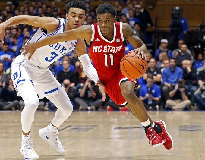 FILE - In this Feb. 16, 2019, file photo, North Carolina State's Markell Johnson (11) drives against Duke's Tre Jones (3) during the first half of an NCAA college basketball game, in Durham, N.C. Johnson is the top returning scorer for the Wolfpack and is a preseason all-Atlantic Coast Conference second-team pick. (AP Photo/Chris Seward, File)