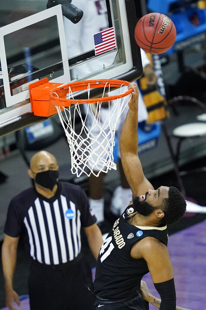 Colorado forward Jeriah Horne (41) misses a dunk during the first half of a second-round game against Florida State in the NCAA college basketball tournament at Farmers Coliseum in Indianapolis, Monday, March 22, 2021. (AP Photo/Charles Rex Arbogast)