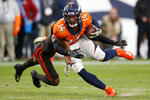 Denver Broncos wide receiver Courtland Sutton (14) is hit by Cleveland Browns cornerback Denzel Ward during the second half of NFL football game Sunday, Nov. 3, 2019, in Denver. (AP Photo/David Zalubowski)