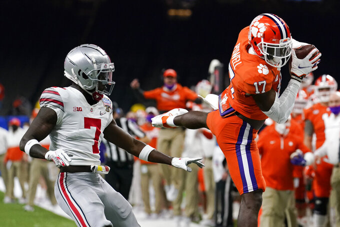 Clemson wide receiver Cornell Powell catches a pass in front of Ohio State cornerback Sevyn Banks during the first half of the Sugar Bowl NCAA college football game Friday, Jan. 1, 2021, in New Orleans. (AP Photo/Gerald Herbert)