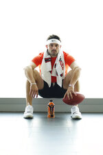 This Aug. 7, 2019, photo provided by BODYARMOUR shows Cleveland Browns quarterback Baker Mayfield posed in Cleveland. The Browns' star quarterback has added sports drink BODYARMOR to his growing list of endorsements. (Jason Libal/BODYARMOUUR via AP)
