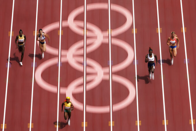Shelly-Ann Fraser-Pryce, of Jamaica, wins her heat during the semifinals in the women's 200-meter at the 2020 Summer Olympics, Monday, Aug. 2, 2021, in Tokyo. (AP Photo/Morry Gash)