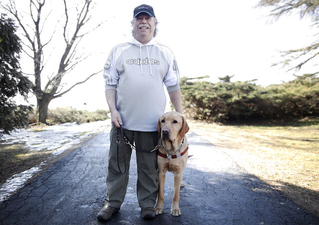 Tom Garrett recently graduated from Guiding Eyes for the Blind with a new guide dog, Clifford. He and Clifford have gotten to know each other in recent weeks, and the match has been life-changing, Garrett says  (Anthony Wahl./The Janesville Gazette via AP)