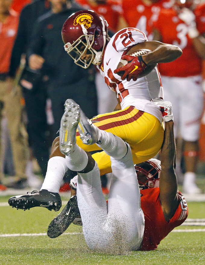 Utah defensive back Marquise Blair, below, tackles Southern California wide receiver Tyler Vaughns (21) during the first half of an NCAA college football game Saturday, Oct. 20, 2018, in Salt Lake City. (AP Photo/Rick Bowmer)