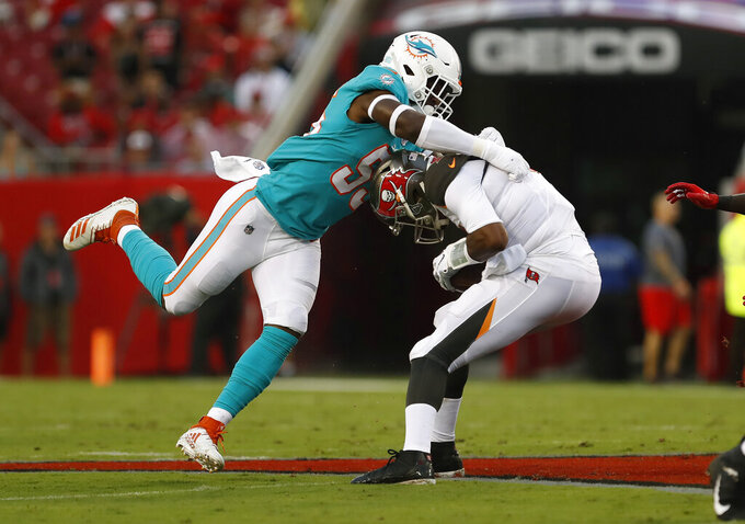 Miami Dolphins outside linebacker Jerome Baker (55) wraps up Tampa Bay Buccaneers quarterback Jameis Winston (3) during the first half of an NFL preseason football game Friday, Aug. 16, 2019, in Tampa, Fla. (AP Photo/Mark LoMoglio)