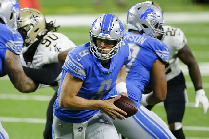 Detroit Lions quarterback Matthew Stafford prepares to hand off during the first half of an NFL football game against the New Orleans Saints, Sunday, Oct. 4, 2020, in Detroit. (AP Photo/Duane Burleson)