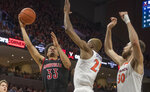 Louisville forward Jordan Nwora (33) shoots over Virginia defenders Mamadi Diakite (25) and Jay Huff (30) during the first half of an NCAA college basketball game in Charlottesville, Va., Saturday, March 7, 2020. (AP Photo/Lee Luther Jr.)
