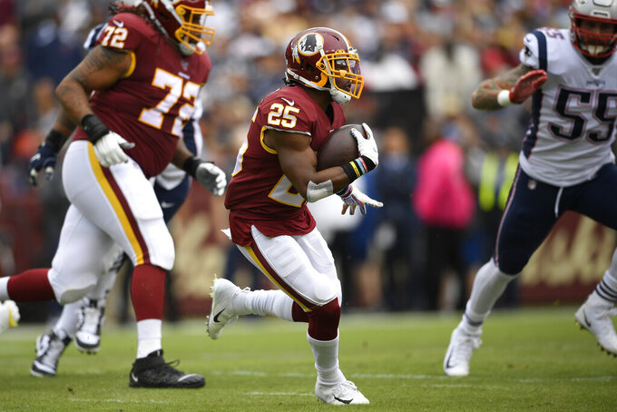 Washington Redskins running back Chris Thompson (25) runs against the New England Patriots during the first half of an NFL football game, Sunday, Oct. 6, 2019, in Washington. (AP Photo/Nick Wass)