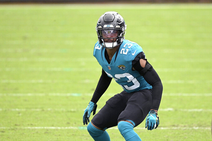 """FILE - Jacksonville Jaguars cornerback CJ Henderson (23) follows a play during the second half of an NFL football game against the Houston Texans in Jacksonville, in this Sunday, Nov. 8, 2020, file photo. Henderson hasn't been the same since a shoulder injury last October. New coach Urban Meyer raved about Henderson's rehab in March and said """"we're counting on him."""" But Meyer's faith in Henderson seems to be waning. (AP Photo/Phelan M. Ebenhack, File)"""