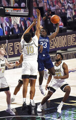 Longwood's Jermaine Drewey shoots under pressure from Wake Forest's Tariq Ingraham during the first half of an NCAA basketball game Friday, Nov. 27, 2020, in Winston-Salem, N.C. (Walt Unks/The Winston-Salem Journal via AP, Pool)