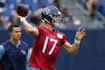 Tennessee Titans quarterback Ryan Tannehill throws during NFL football training camp Monday, Aug. 16, 2021, in Nashville, Tenn. (AP Photo/Mark Humphrey)