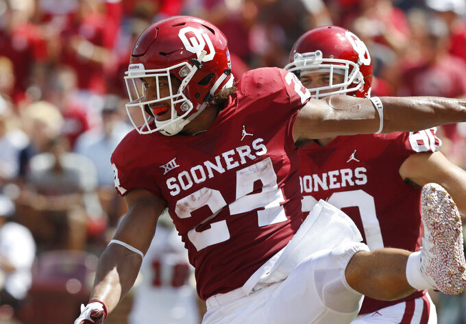 Oklahoma running back Rodney Anderson (24) celebrates a touchdown in the first half of an NCAA college football game against Florida Atlantic in Norman, Okla., Saturday, Sept. 1, 2018. (AP Photo/Sue Ogrocki)