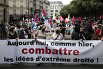 """Demonstrators hold a banner reading """"Yesterday and today, fighting far-right ideas"""" during a demonstration, Saturday, June 12, 2021 in Paris. Thousands of people rallied throughout France Saturday to protest against the far-right. (AP Photo/Lewis Joly)"""